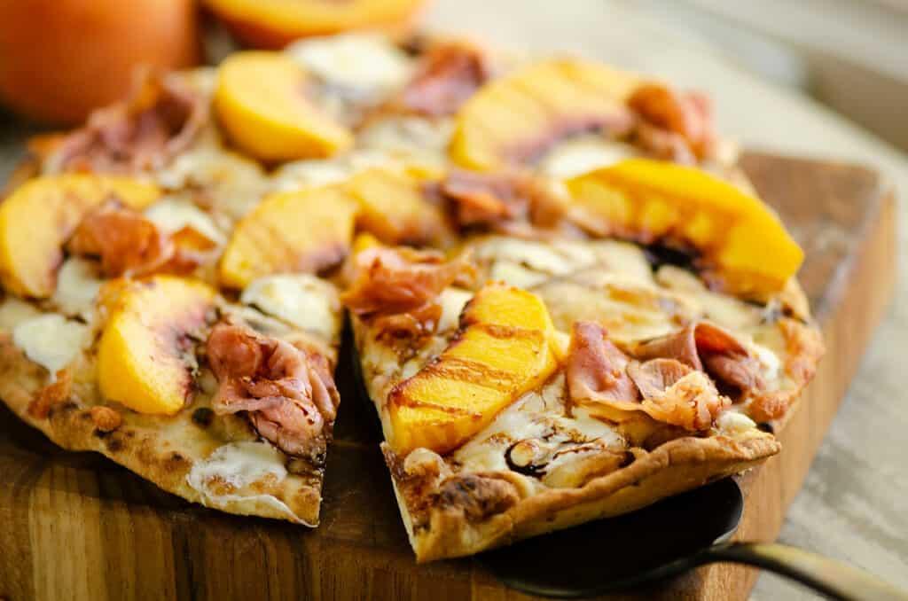 slice of peach pizza on server
