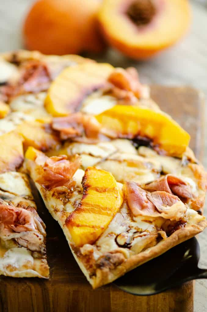 slice of peach pizza removed from pizza