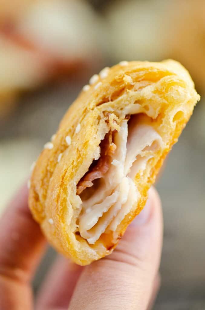 inside of turkey bacon swiss crescent roll in hand